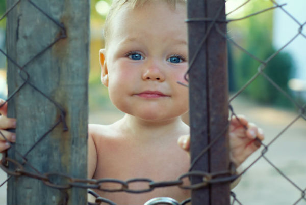 Baby behind a locked fence | Cloud Surfing Media Digital Marketing Toronto